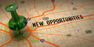 New Opportunities Concept - Green Pushpin on a Map Background with Selective Focus.