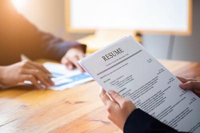 bigstock-Interviewer-Reading-A-Resume--310333042-sm